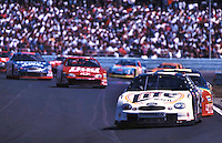 Pole position winner Rusty Wallace leads a pack of cars in the Frontier at the Glen Winston Cup race in Watkins Glen, New York 8/15/99.  The race was eventually won by Jeff Gordon.(Photo by Brian Cleary)  Frontier at the Glen, Watkins Glen International Raceway, Watkins Glen, NY, August 15, 1999.  (Photo by Brian Cleary/www.bcpix.com)