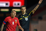 Wales Captain Craig Bellamy alongside Referee Mattias Gestranius (Finland)during the International Friendly between Wales and Luxembourg at Parc y Scarlets in LLanelli..
