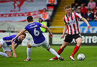 Lincoln City's Scott Wharton vies for possession with Exeter City's Jordan Tillson<br /> <br /> Photographer Andrew Vaughan/CameraSport<br /> <br /> The EFL Sky Bet League Two Play Off First Leg - Lincoln City v Exeter City - Saturday 12th May 2018 - Sincil Bank - Lincoln<br /> <br /> World Copyright &copy; 2018 CameraSport. All rights reserved. 43 Linden Ave. Countesthorpe. Leicester. England. LE8 5PG - Tel: +44 (0) 116 277 4147 - admin@camerasport.com - www.camerasport.com