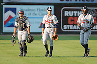Starting pitcher Sean Gilmartin (2) of the Rome Braves walks to the dugout with catcher Ryan Query and pitching coach Derrick Lewis prior to a game against the Greenville Drive on August 16, 2011, at Fluor Field at the West End in Greenville, South Carolina. Gilmartin was Atlanta's first-round pick (No. 28 overall) in the 2011 First-Year Player Draft out of Florida State. Making his second start of the season, he pitched four scoreless innings, giving up one hit and striking out four. (Tom Priddy/Four Seam Images)