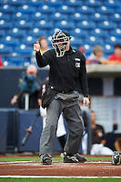 Umpire Jordan Johnson makes a call during the first game of a doubleheader between the Wisconsin Timber Rattlers and Quad Cities River Bandits on August 19, 2015 at Modern Woodmen Park in Davenport, Iowa.  Quad Cities defeated Wisconsin 3-2.  (Mike Janes/Four Seam Images)