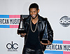 "USHER WITH HIS AWARDS.American Music Awards 2010,Nokia Rheatre, Los Angeles_21/10/2010.Mandatory Photo Credit: ©Dias/Newspix International..**ALL FEES PAYABLE TO: ""NEWSPIX INTERNATIONAL""**..PHOTO CREDIT MANDATORY!!: NEWSPIX INTERNATIONAL(Failure to credit will incur a surcharge of 100% of reproduction fees)..IMMEDIATE CONFIRMATION OF USAGE REQUIRED:.Newspix International, 31 Chinnery Hill, Bishop's Stortford, ENGLAND CM23 3PS.Tel:+441279 324672  ; Fax: +441279656877.Mobile:  0777568 1153.e-mail: info@newspixinternational.co.uk"