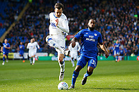 Carl Jenkinson of Birmingham City fails to clear the ball under pressure from Junior Hoilett of Cardiff City during the Sky Bet Championship match between Cardiff City and Birmingham City at the Cardiff City Stadium, Wales, UK. Saturday 10 March 2018