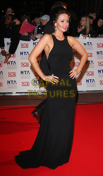 JENNIFER METCALFE.The 15th National Television Awards held at the O2 Arena, London, England. .January 20th, 2010 .NTA NTAs full length black maxi sleeveless dress hands on hips .CAP/ROS.©Steve Ross/Capital Pictures.