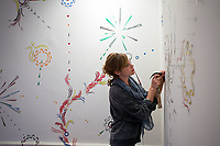 Professor Mary Beth Heffernan works with students as they install their Studio Art Comps Exhibition in Weingart and Mullin Galleries, November 28, 2012. Featuring the work of: Elise Augenstern, Margaret Gallagher, Claire Larson, Eliza Miller, Chanler Murphy, Leah Trujillo and Carly Wright.<br /> (Photo by Marc Campos, Occidental College Photographer)