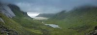 Clouds conceal mountain peaks surrounding Horseid beach, Moskenesoy, Lofoten Islands, Norway