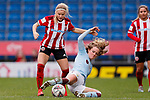 Olivia Fergusson of Sheffield United is tackled by of Aston Villa during the The FA Women's Championship match at the Proact Stadium, Chesterfield. Picture date: 12th January 2020. Picture credit should read: James Wilson/Sportimage