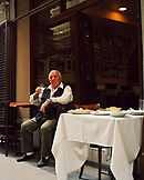 TURKEY, Istanbul, Mr. Refik having a drink outside his Refik Restaurant