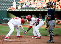 Oscar Taveras (25) of the Springfield Cardinals celebrates with teammate ermaine Curtis (22) after hitting a two run home run during a game against the Arkansas Travelers at Hammons Field on July 25, 2012 in Springfield, Missouri. (David Welker/Four Seam Images)