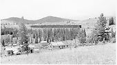 D&amp;RGW MoW facilities at Marshall Pass summit.  The Marshall Pass snowshed is in the center distance and the section house, bunkhouses and various sheds are in the foreground.<br /> D&amp;RGW  Marshall Pass, CO  Taken by Richardson, Robert W. - 9/1955
