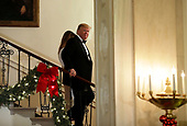 United States President Donald J. Trump and First Lady Melania Trump descend the Grand Staircase as they arrive at the Congressional Ball at White House in Washington on December 15, 2018. <br /> Credit: Yuri Gripas / Pool via CNP