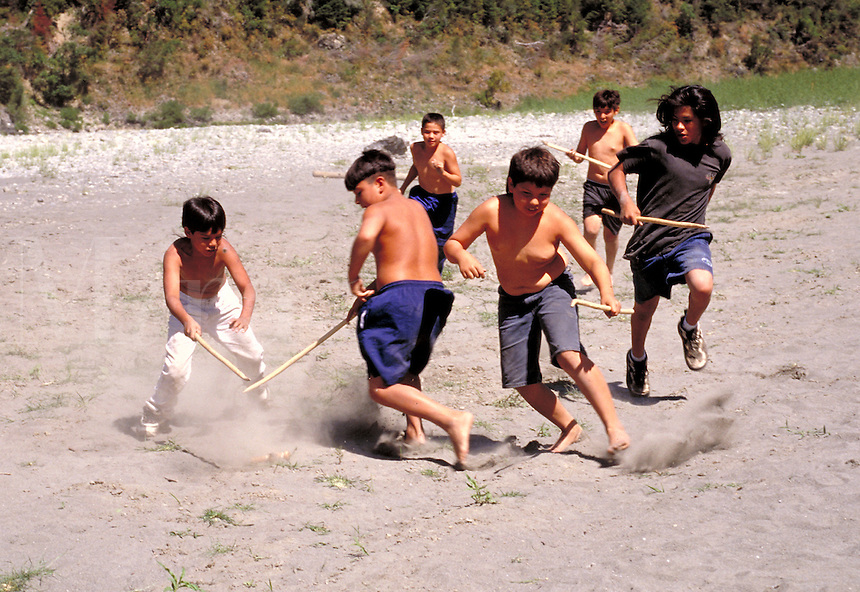 Yurok boys playing a game of stickball at a cultural camp on the banks of the Klamath River, California