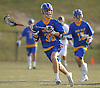 Danny Penny #38 of West Islip looks to pass during a Suffolk County varsity boys lacrosse game against Northport at Veterans Park in East Northport on Monday, Apr. 18, 2016. West Islip won by a score of 10-9.