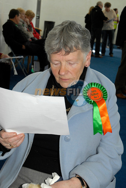 .A Killian supporter checks the latest figures at the General Election Count in Meath East, Ashbourne, Co Meath. 26/2/2011..Picture Andy Spearman/www.newsfile.ie.