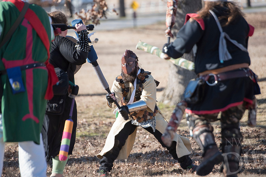 NWA Democrat-Gazette/J.T. WAMPLER Cory Johns, known as Jent, center, fends of a horde of attackers Sunday Jan. 3, 2016 while participating in a live action role playing game, or LARP, at Agri Park in Fayetteville.  Around 15 members of the Shire of Razor Hills meet every Sunday at the park to engage in the live action combat game and use padded weapons to bludgeon each other during a variety of strategy scenarios. For more photos go to http://nwamedia.photoshelter.com/
