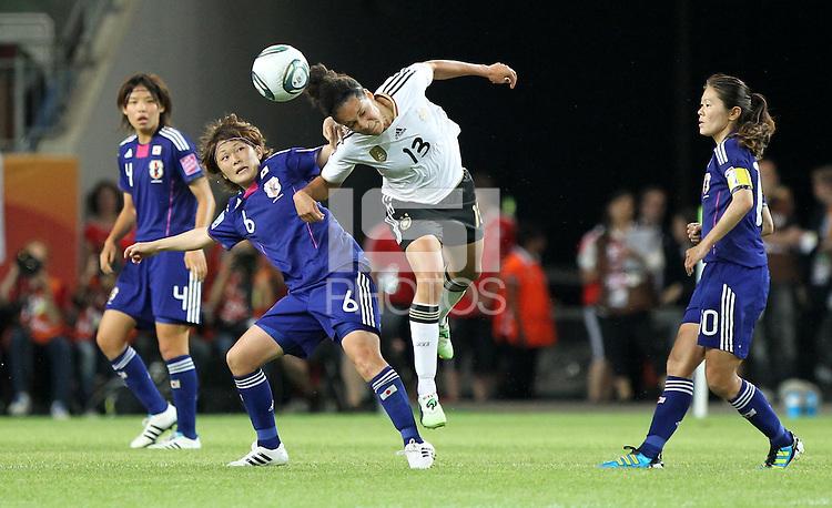 Wolfsburg , 100711 , FIFA / Frauen Weltmeisterschaft 2011 / Womens Worldcup 2011 , Viertelfinale ,  Deutschland (GER) - Japan (JPN) .Celia Okoyino Da Mbabi (GER) gegen Mizuho Sakaguchi (JPN) .Foto:Karina Hessland .