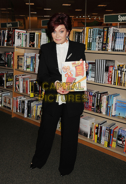 Sharon Osbourne<br /> signs copies of her new book &quot;Mama Hook Knows Best&quot; at Barnes &amp; Noble bookstore at The Grove in Los Angeles, California,<br /> USA, September 18th, 2013.<br /> full length holding book trousers suit white shirt black jacket <br /> CAP/ROT/TM<br /> &copy;Tony Michaels/Roth Stock/Capital Pictures