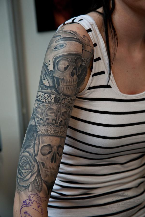 Copenhagen Inkfestival 2012. Black and grey tattoo with skulls on arm.