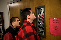People try to see Mitt Romney speak at a Romney town hall campaign event at McKelvie Intermediate School in Bedford, New Hampshire, on Jan. 9, 2012.  Romney is seeking the 2012 Republican presidential nomination.