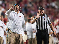 STAFF PHOTO ANTHONY REYES • @NWATONYR<br /> Arkansas head coach Bret Bielema calls out to his players against Northern Illinois University in the fourth quarter Saturday, Sept. 20, 2014 at Razorback Stadium in Fayetteville. The Razorbacks won 52-14.
