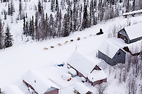 Thursday March, 2012   Justin Savidis passes old mining buildings as he travels through the historic mining district on his way to the Ophir checkpoint.   Iditarod 2012.