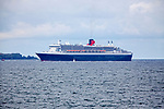 "the Queen Mary 2 passing Groix Island, on her way to Saint Nazaire for the start of the centennial Transat ""The Bridge 2017"", a historic transatlantic race between her and a fleet of giant trimarans."