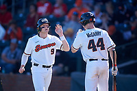 Oregon State Beavers Andy Armstrong (9) is congratulated by Alex McGarry (44) after scoring a run during an NCAA game against the New Mexico Lobos at Surprise Stadium on February 14, 2020 in Surprise, Arizona. (Zachary Lucy / Four Seam Images)