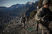 US Army Soldiers from Viper Company 126, 1st Platoon, patrol near Restrepo Firebase in the restive Korengal Valley. Restrepo, a remote outpost, is known as one of the most violent places in Afghanistan. Located in the Korengal Valley it comes under fire on a daily basis from Anti-Afghan Forces in the local villages and mountains.