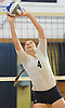 Massapequa No. 4 Jamie Smith makes a set during a Nassau County varsity girls' volleyball game against Plainview JFK at Massapequa High School on Wednesday, September 9, 2015. Massapequa rallied from a 19-10 deficit in the first set to win 25-21, 25-14, 25-16.<br /> <br /> James Escher