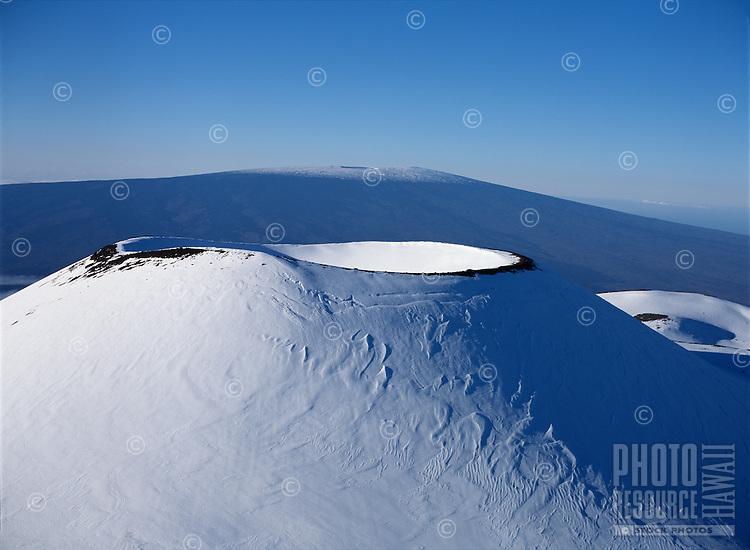 Snow covered cinder cone, Mauna Kea, Hawaii..The cinder cone is named Puu Hau Kea.