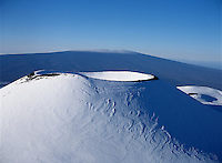 Snow covered cinder cone, Mauna Kea, Hawaii..The cinder cone is named Puu Hau Kea.