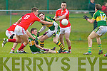 Jonathan Lyne and David Moran Kerry in action against Aidan Walsh  and Paul Kerrigan  Cork in the McGrath cup final at Mallow on Sunday.