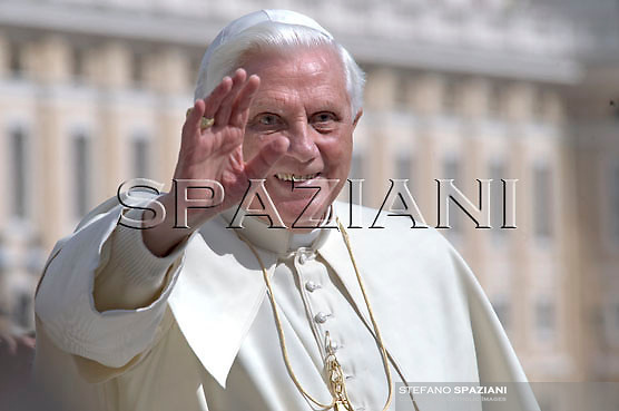 Pope Benedict XVI waves to the faithful during his weekly general audience in St. Peter's square at the Vatican, Wednesday March 11, 2009.