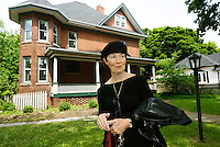 Mary Ann Raaymakers stands in front of a home on MacKenzie Street which is being renovated  and upgraded for senior women.