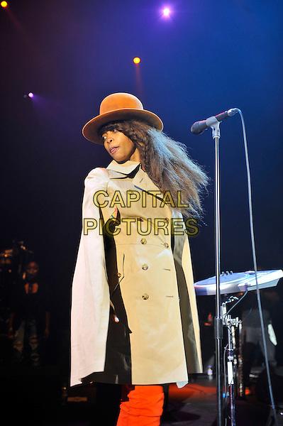 Erykah Badu performing live in concert, Hammersmith Apollo, London, England. 27th June 2012.on stage gig performance half  length beige mac orange jeans denim cape hat       .CAP/MAR.© Martin Harris/Capital Pictures.