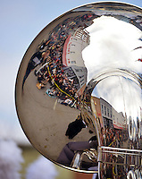 STAFF PHOTO BEN GOFF  @NWABenGoff -- 12/13/14 A Sousaphone carried by the Bentonville High School marching band reflects the crowd gathered in front of the Walmart Museum during the Bentonville Christmas parade on Saturday Dec. 13, 2014.