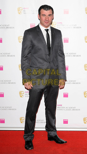 JOE CALZAGHE .The Game BAFTA Video Game Awards, Hilton Hotel, Park Lane, London, England, UK, 16th March 2011..full length grey gray suit black tie .CAP/CAN.©Can Nguyen/Capital Pictures.