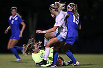 16 October 2015: Duke's EJ Proctor (30) grabs the ball in front of North Carolina's Katie Bowen (NZL) (in white) and Duke's Kara Wilson (right). The University of North Carolina Tar Heels hosted the Duke University Blue Devils at Fetzer Field in Chapel Hill, NC in a 2015 NCAA Division I Women's Soccer game. Duke won the game 1-0.