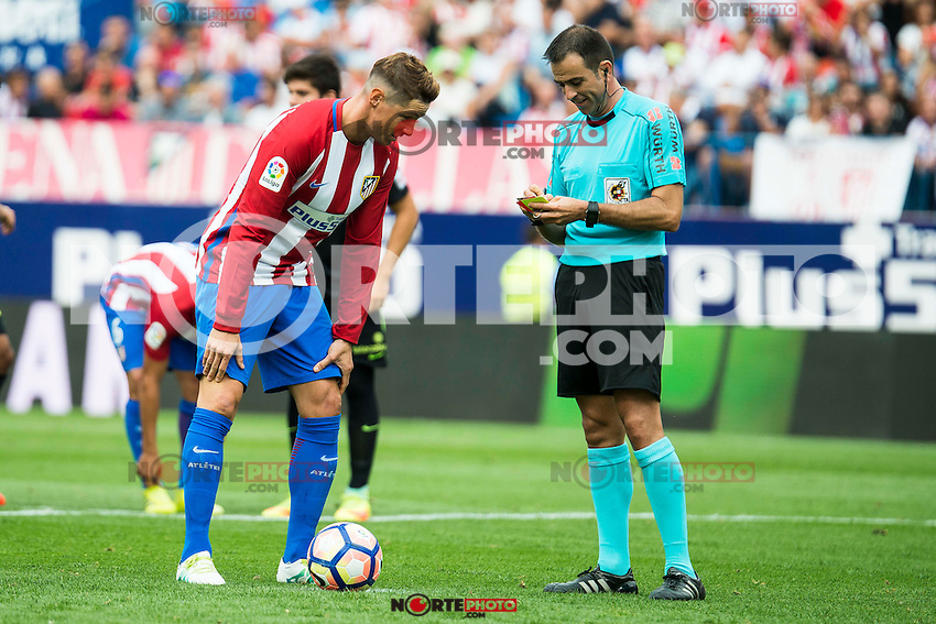 The referee talking with Atletico de Madrid's player Fernando Torres and Sporting de Gijon's XXX during a match of La Liga Santander at Vicente Calderon Stadium in Madrid. September 17, Spain. 2016. (ALTERPHOTOS/BorjaB.Hojas) /NORTEPHOTO