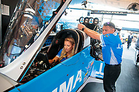 Sep 29, 2019; Madison, IL, USA; Crew members with NHRA top fuel driver Leah Pritchett during the Midwest Nationals at World Wide Technology Raceway. Mandatory Credit: Mark J. Rebilas-USA TODAY Sports
