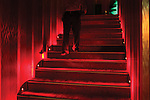 A customer walks down the plush red staircase to the dining room at the Lebanese Club in Baghdad, Iraq, June 6, 2010. The club does not serve alcohol. Some businessmen, like the club's Lebanese manager Antoine El-Hage, are seeing money-making opportunities in Baghdad's nightlife.