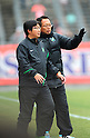 (R-L)  Takeshi Okada,  Suzuki (Greentown),.FEBRUARY 25, 2012 - Football / Soccer :.Hangzhou Greentown FC head coach Takeshi Okada during a pre-season match between Omiya Ardija and Hangzhou Greentown FC at NACK5 Stadium Omiya in Saitama, Japan. Okada is a former Japan national team coach.