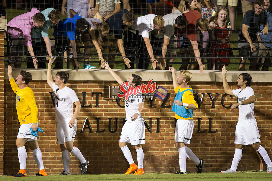 Wake Forest Demon Deacons players high five fans after their victory over the Santa Clara Broncos at Spry Soccer Stadium on August 28, 2015 in Winston-Salem, North Carolina.  The Demon Deacons defeated the Broncos 1-0.  (Brian Westerholt/Sports On Film)