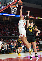 COLLEGE PARK, MD - FEBRUARY 13: Stephanie Jones #24 of Maryland goes up over McKenna Warnock #14 of Iowa for a shot during a game between Iowa and Maryland at Xfinity Center on February 13, 2020 in College Park, Maryland.