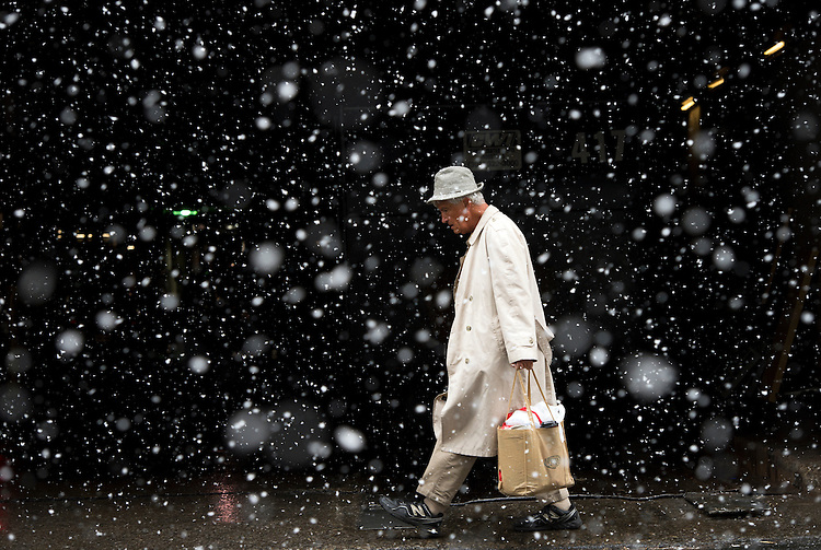 UNITED STATES - FEBRUARY 25: A man makes his way down 1st., Street, NE, near Union Station, during a snowy Tuesday morning.(Photo By Tom Williams/CQ Roll Call)