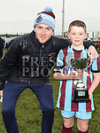 Ciaran O'Brien from Drogheda League presents Drogheda Marsh Crescent captain Chris Murtagh with the winners trophy.  Photo:Colin Bell/pressphotos.ie
