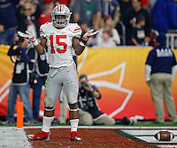 Ohio State Buckeyes running back Ezekiel Elliott (15) celebrates his rushing touchdown in honor of defensive lineman Joey Bosa (97) who was injected in the 1st quarter for targeting against Notre Dame Fighting Irish in the third quarter during the Fiesta Bowl in the University of Phoenix Stadium on January 1, 2016.  (Dispatch photo by Kyle Robertson)
