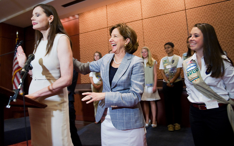 "UNITED STATES - JULY 13:  Sen. Kay Hagan, D-N.C., center, shares a laugh with Geena Davis, actor and founder of the Geena Davis Institute on Gender in the Media, as Girl Scout Katie McGrath, 16, looks on, during a news conference in the Capitol Visitor Center to support the Healthy Media for Youth Act, which would ""improve media literacy for youth and encourage the promotion of healthier media messages about girls and women.""  (Photo By Tom Williams/Roll Call)"