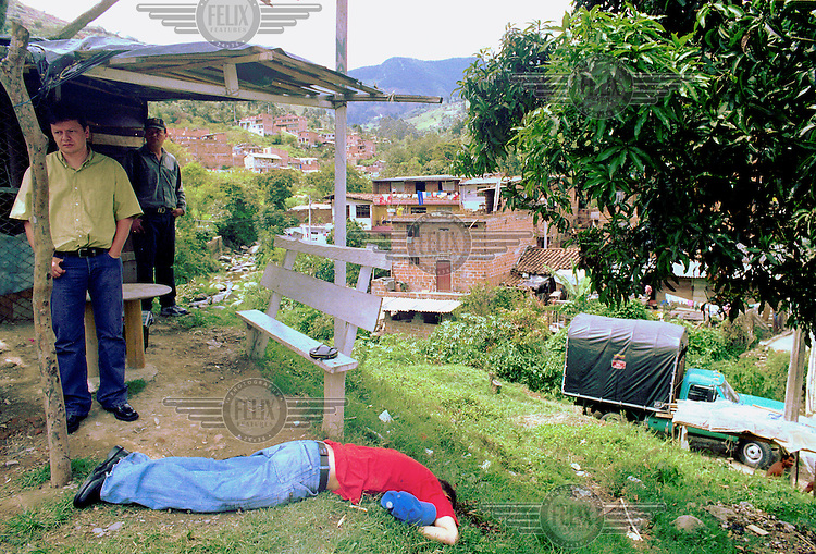 ©Paul Smith/Panos Pictures..COLOMBIA: MedellÌn..A youth who gunned down by a shot to the back of the head in an outlying neighbourhood of MedellÌn. Freshly showered and in immaculate clothes, he had been called to meet with right-wing paramilitaries, who executed him.