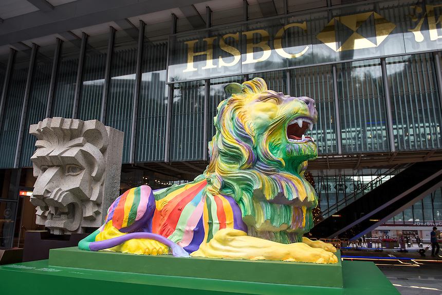 Rainbow pride lions are displayed in support of LGBTI people at the HSBC Headquarters in Central Hong Kong. Their display has caused controversy and prompted a petition for their removal as well as threats by customers to close their accounts. <br /> The lions are replicas in rainbow colours of Stephen and Stitt, the bank&rsquo;s iconic lions, in front of its main building.<br /> The statues, designed by local LGBT artist Michael Lam,represent pride and unity in diversity, with Stephen painted in stripes (pictured) and Stitt in circles. Throughout the bank&rsquo;s history, the lions have stood for courage and prosperity.#HSBCPride .<br /> &copy; Jayne Russell 6th December 2016